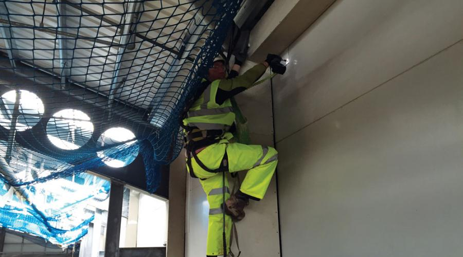 Installing walling using rope access